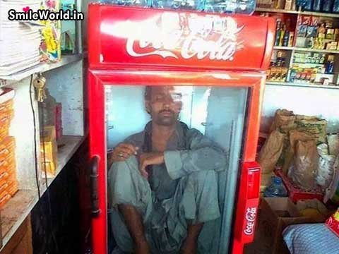 Indian Man Sitting in The Fridge Funny Hot Summer Pics